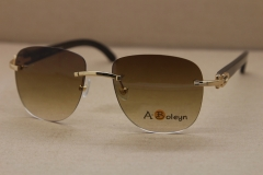Cartier Rimless Sunglasses T8300680 Original Black Buffalo Horn Sunglasses in Gold Brown Lens