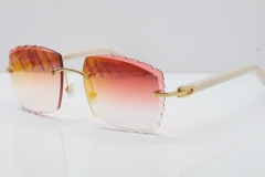 Cartier Rimless Aztec Arms 8300816 Carved Lens Sunglasses In Gold Red Mirror Lens